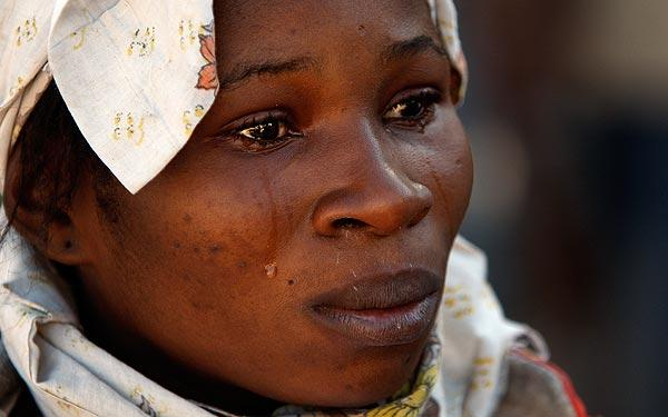 A woman weeps after seeing the body of a neighbor who died in the devastating earthquake that rocked Haiti two days ago.