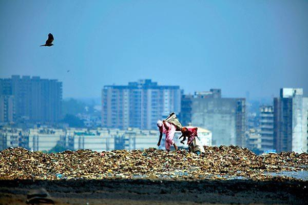 Rag pickers scavenge for food and recyclables at New Delhi's 70-acre Ghazipur landfill. The city produces about 9,200 tons of trash daily, up 50% from 2007. The garbage is expected to double by 2024, leaving Ghazipur and two other landfills overflowing.