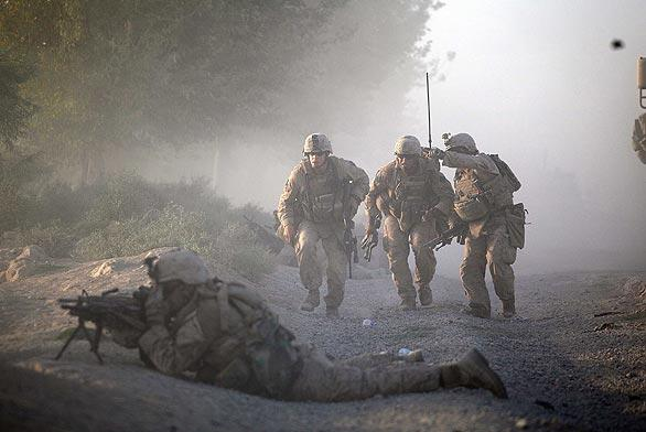 U.S. Marines with the 2nd Marine Expeditionary Brigade, RCT 2nd Battalion 8th Marines Echo Co. move into position while they were under enemy fire on July 17, 2009 in Mian Poshteh, Afghanistan.