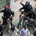 followed by Iranian riot-police