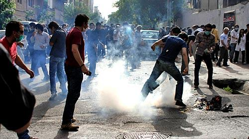 Protesters in Tehran try to protect themselves from tear gas fired by Iranian authorities in this photo obtained by the Associated Press.