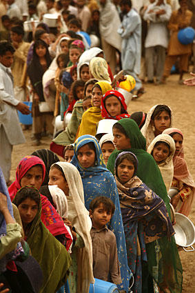"Women queue in a separate line for food at Little Lahore camp. "" ""The real test is how quickly the refugees will be able to get back to their homes,"" U.S. envoy Holbrooke said at a news conference in Islamabad."
