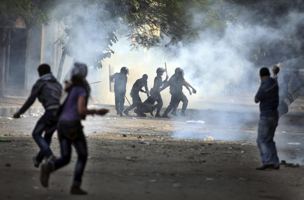 Egyptian protesters and police clashed in Cairo just hours ahead of a planned massive rally by opponents of the country's Islamist president demanding he rescinds decrees that granted him near-absolute powers.