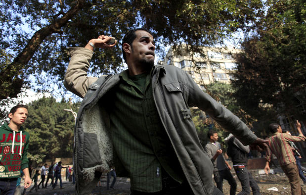 Egyptian protesters clash with security forces near Tahrir Square in Cairo, where an opposition rally has been called to express rejection of President Mohamed Morsi's seizure of near absolute powers.