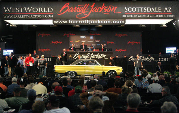 A 1967 Plymouth GTX rolls onto the auction block at the Barrett-Jackson Car Auction in Scottsdale, Ariz.