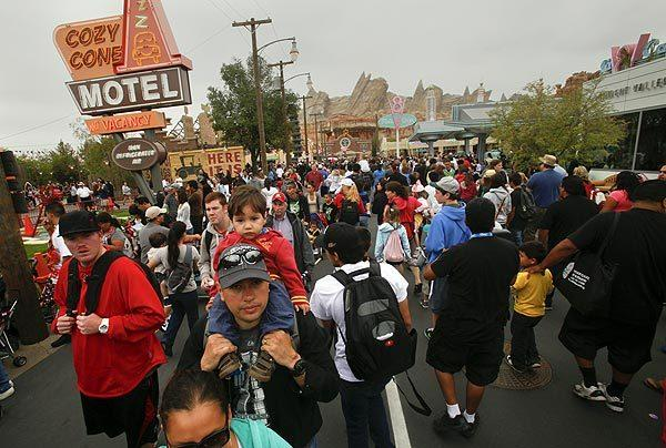 Visitors crowd onto Route 66 in Cars Land, where new rides, shops and restaurants opened to the public at Disney California Adventure.
