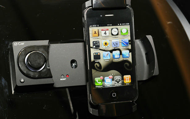 Oxygen Audio's O Car lets users control car stereo functions and all of the iPhone's applications via Apple's iPhone touch screen and can be set up with the iPhone in either the vertical or horizontal position. The O Car provides access to iTunes and allows users to listen to radio stations.