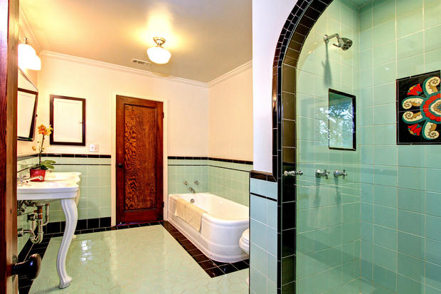 The bathrooms have been restored with period tile in keeping with the house's original character.