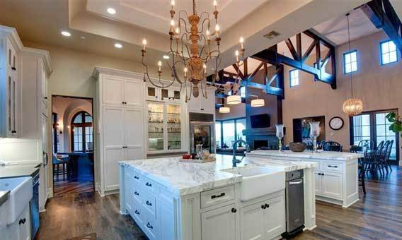 The kitchen centers on a large island with a farm-style sink.
