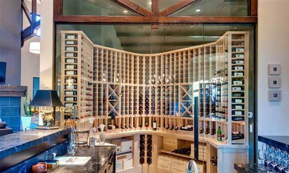 A glass-enclosed, temperature-controlled wine room sits at the back of the bar.