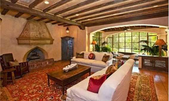 The main house features wood-beam ceilings and multiple fireplaces.