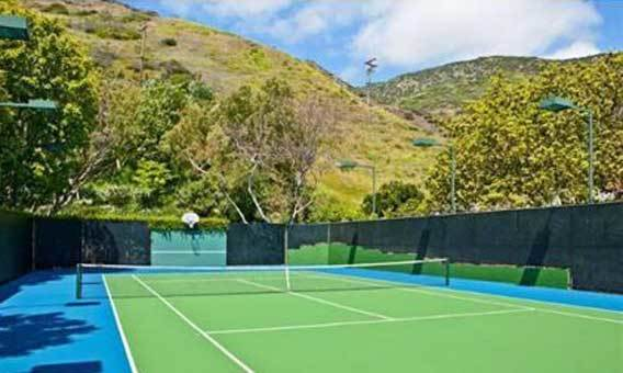 Among amenities is a light tennis court.