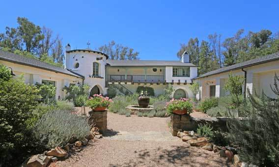 The Spanish-style house actress Reese Witherspoon is selling centers on a courtyard.