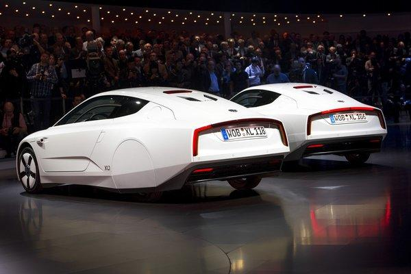 Two new Volkswagen hybrid XL1 model cars are displayed during a preview of Volkswagen Group on March 4, 2013 ahead of the Geneva Car Show in Geneva. The car, which will not be sold in the U.S., will get up to 261 mpg through a hybrid of a diesel motor and an electric motor.