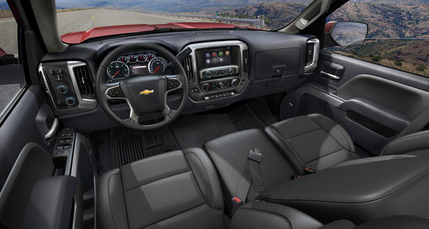 The interior of the 2014 Chevy Silverado pickup. New optional features include a lane-departure warning system and a front-park assist function.