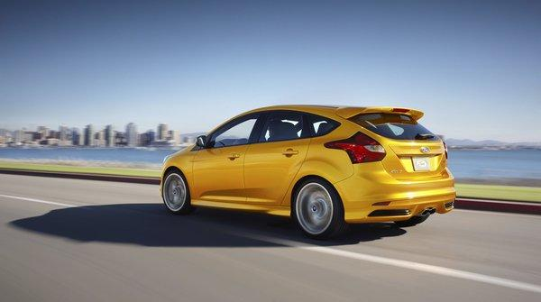 "This Ford Focus ST is the least expensive car on the list with a starting price of $23,700. ""Ford used to save its best small cars for the European market. Thankfully, those days are over. We believe this four-door hatch with over 250 horsepower and performance handling is an undeniable bargain under $25K that will attract collectors many years down the road,"" says Hagerty. Read <a href=""http://www.latimes.com/business/autos/la-fi-hy-autos-ford-focus-st-rapid-review-20130126,0,4360932.story""><span class=""center_label"">our review</span></a>."