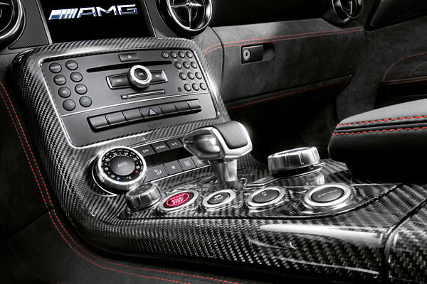 Unfortunately, as is the case on the SLS AMG Roadster we tested in early 2012, the car still has Mercedes' outdated center console setup and design. Customers who want to really save weight can delete this Comand multimedia system, a move Mercedes says saves you another 13 pounds.
