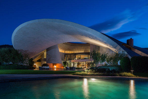 "The massive Palm Springs home designed by renowned modern architect John Lautner for comedian Bob Hope is for sale for $50 million. The concrete, steel and glass house was built in 1979 and has about 22,000 square feet of living space.<br><b>More: </b><a href=""http://articles.latimes.com/2013/feb/28/business/la-fi-mo-hotprop-bob-hope-20130228"" target=""_blank"">Giant curving copper roof plays off the shape of the nearby mountains.</a>"
