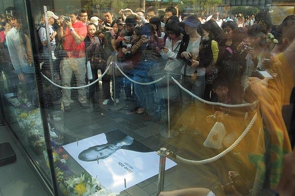 People mourn Apple co-founder Steve Jobs at an Apple store at Sanlitun Village. Jobs, 56, passed away after a long battle with pancreatic cancer. Jobs co-founded Apple in 1976 and is credited, along with Steve Wozniak, with marketing the world's first personal computer in addition to the popular iPod, iPhone and iPad.