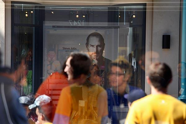 A photo of Steve Jobs is displayed on the main screen of the Apple store on the Third Street Promenade in Santa Monica.