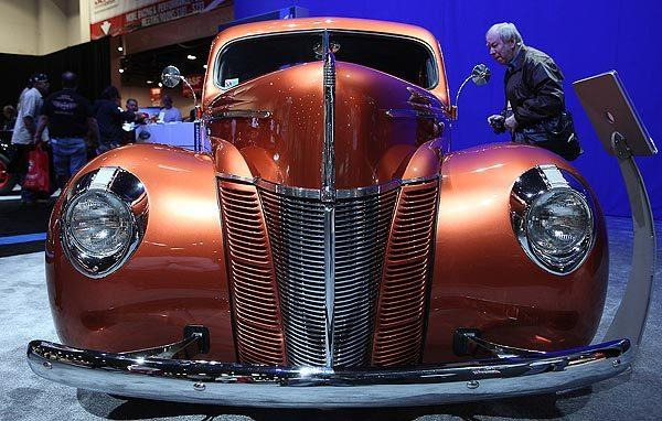 "A man looks inside the 1940 ""Catch Me If You Can!"" Ford coupe."