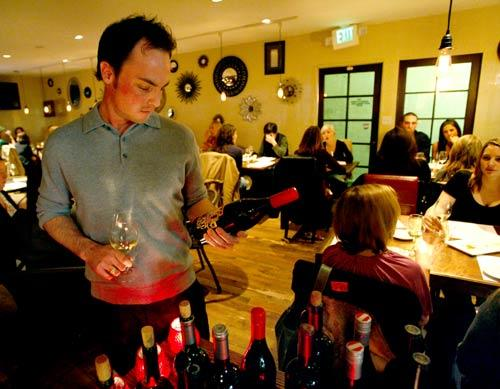 Sommelier Ryan Hess picks wine in the restaurant and wine bar on Melrose Avenue.
