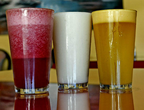 At El Bolivar, fruit juices with milk: blackberry, left, sour sop and passion fruit.