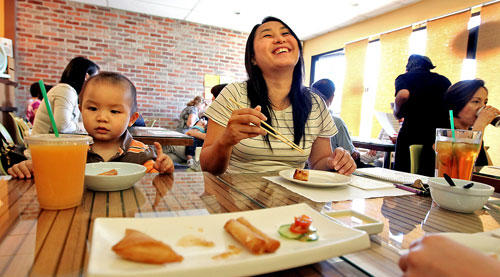 Katie Mac and her son Kyle Fung, 21-months-old, have lunch at Green Zone, which specializes in fine organic cuisine, in San Gabriel.