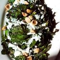 Grilled Russian kale with yogurt dressing and toasted hazelnuts