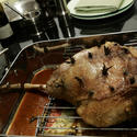 Roast leg of lamb is studded with sprigs of rosemary, anchovy fillets and garlic.