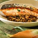 Crispy-skinned salmon with lentils, bacon and dandelion greens