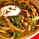 Chickpea and noodle soup with spinach, Persian herbs and kashk topping