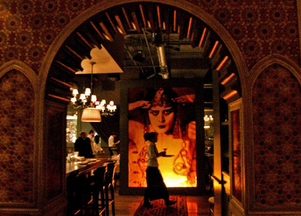 The image of silent-film actress Theda Bara as Cleopatra graces the entrance of Cleo in the Redbury Hotel in Hollywood.