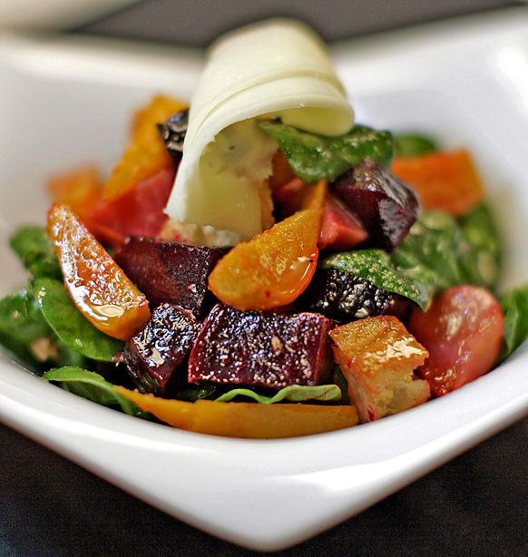The <i>panzanella</i> with cubes of heirloom beets is tossed with crunchy croutons, spinach and thinly shaved truffled pecorino.