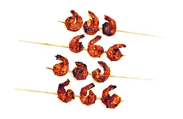"Translation: Skewered, grilled shrimp. <a href=""http://www.latimes.com/features/food/la-fo-0630-matt-armendarizrec2-20110630,0,2178761.story"" target=""_blank"">Click here for the recipe.</a>"