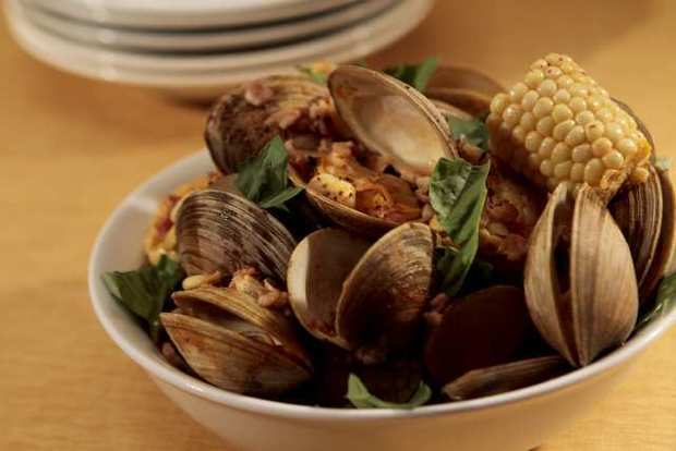 "Steamed corn with clams and bacon. <a href=""http://www.latimes.com/features/food/la-fo-virbilarec2-20120922,0,1150907.story"">Recipe</a>"