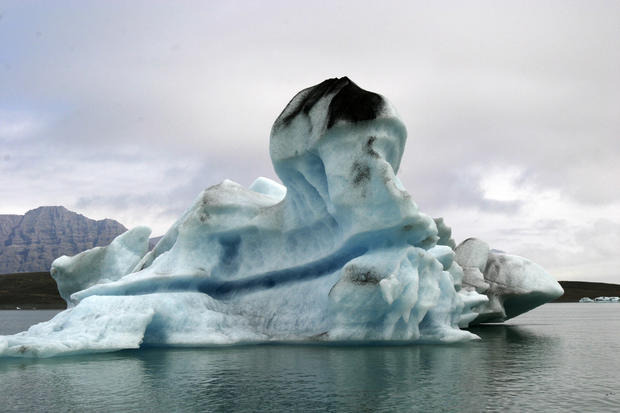 A black mark on top of this iceberg floating in Jokulsarlon Lagoon in southeast Iceland means it was once part of a glacier and in contact with the ground.