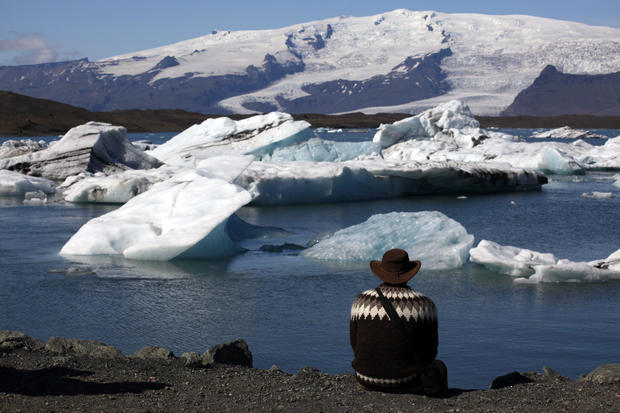 A traveler watches icebergs in Jokulsralon Lagoon in southeast Iceland.