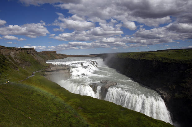 A rainbow lies next to Gullfoss waterfall in south central Iceland.