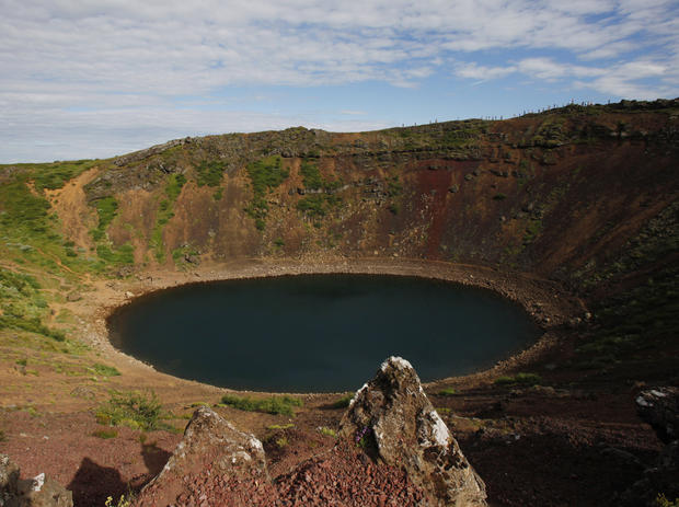 Kerid Crater in south central Iceland features a lake inside its mouth.
