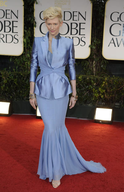 Tilda Swinton in an amazing periwinkle jacket and fishtail hem skirt that I imagine are by Haider Ackermann.