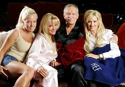 "Hugh Hefner poses with ""The Girls Next Door"" -- from left, Kendra Wilkinson, Bridget Marquardt and Holly Madison -- in 2004."