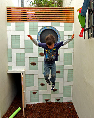 Four-year-old Dustin Bricault can often be found playing in the secret hideout that occupies the narrow space between the home and the church next door. Marc built it as a surprise for the kids, recycling extra building material instead of taking it to the landfill.