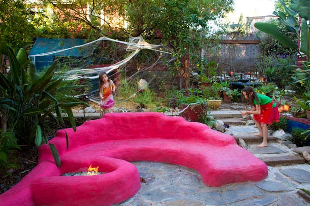 "Ilse Ackerman of Los Angeles built an outdoor lounge area with fire pit using books, Internet advice, YouTube and her own thriftiness. Inspired by Mark Frauenfelder's do-it-yourself book, ""Made by Hand: Searching for Meaning in a Throwaway World,"" Ackerman built the project in three months with inexpensive soil-filled sacks called earthbags. The result: a quirky backyard feature that Ackerman, husband Meeno Peluce and daughters Mette and India Peluce can enjoy. Here's a step-by-step look at how Ackerman built it."