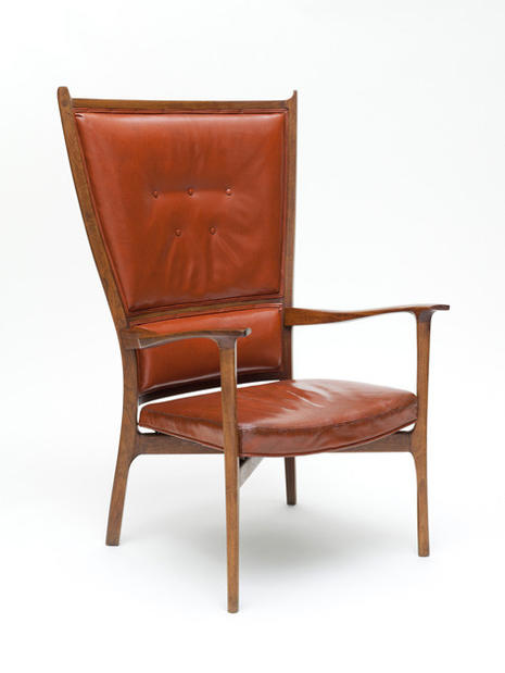 This 1958 walnut and leather chair was designed by John Kapel.
