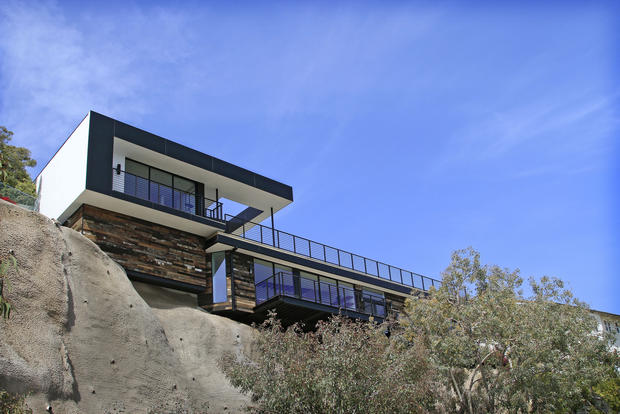 "As seen from Malibu's Broad Beach, the house rises as a streamlined structure set atop a rustic base — ""a juxtaposition between hard lines and soft lines,"" <u><a href=""http://www.wdlosangeles.com"">W+D</a></u> founding partner Brett Woods says. ""Pure geometry coming off this rugged hillside."""