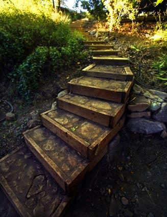 "Handmade steps lead to a sitting area along Santiago Creek.<br> <br> <b>Also in Home & Garden</b><br> <br> • <a href=""http://www.latimes.com/features/home/la-hm.0710.babcock-pg,0,3873569.photogallery"">Bringing an Everett Babcock design back to life</a><br />