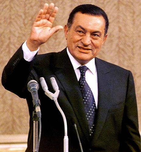 Egyptian President Hosni Mubarak waves to members of the Egyptian Parliament in 1999 after taking the oath of office for a fourth time.