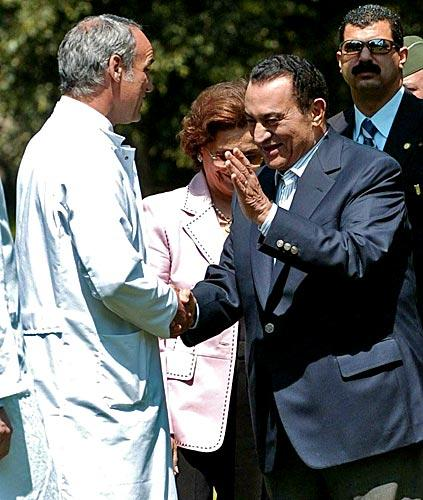 Mubarak shakes hands with Dr. Michael Mayer, left, who operated on the Egyptian president's back in Munich, Germany, in 2004.