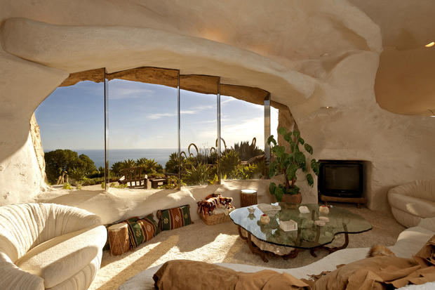 "A whimsical house in Malibu that looks like something out of ""The Flintstones"" was listed by television personality Dick Clark and his wife, Kari, before his death."
